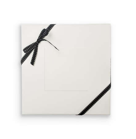 Top view of white giftbox with lable and stitched ribbon. Object is isolated on white background and has soft shadow and clipping path. Stock Photo