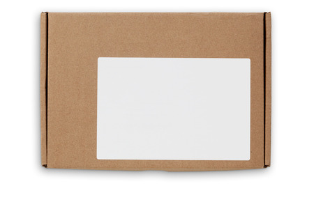 lable: Top view of flat postal packaging box in craft paper with white empty lable. Object is isolated on white background and has soft shadow and clipping path.