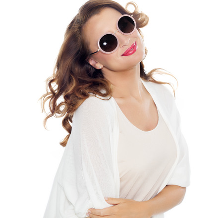 smile face: Happy womean with beautiful hair wearing sunglasses over white background.