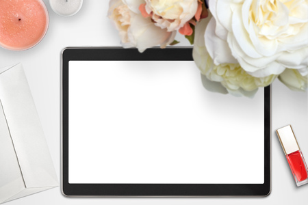 stock photography: Top view scene with tablet, bouquet of peonies and stationery over white background. Styled stock photography. Digital product mockup.