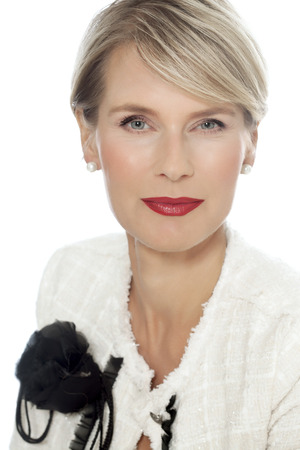 Woman with red lipstick and white jacket. Elegant forty year old woman.