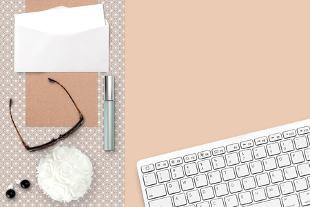 cosmetics products: Top view scene with keyboard, envelope, card, jewelry, sunglasses and makeup over beige background. Styled stock photography. Digital product mockup.