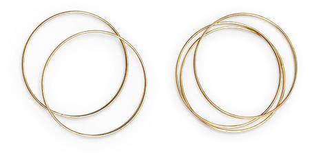 arranged: Golden bangles arranged. Isolated object on white background.