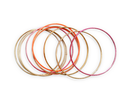 Summer bangles in pink and gold. Isolated object on white background.