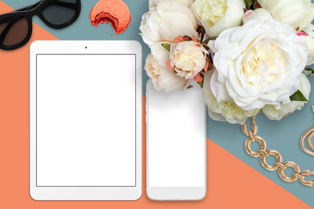 feminine: Elegant top view of desk with tablet, mobile phone and peonies. Styled stock top view mockup scene. Stock Photo