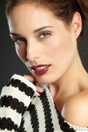 lipgloss: Studio portrait of model with dark red lipgloss. Stock Photo