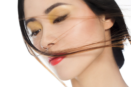 Beautiful young Asian woman portrait with fashionable makeup.