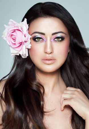 Beautiful exotic woman with excuisite Arabic glitter based makeup.