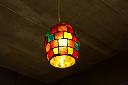 Colorful lanterns hanging on the ceiling concrete