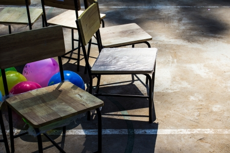 Chairs and Color ball Balloon on Concrete floor