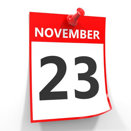 calendario noviembre: 23 de noviembre de hoja de calendario con la clavija roja sobre fondo blanco. Ilustración.