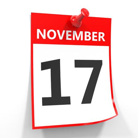 calendario noviembre: 17 de noviembre de hoja de calendario con la clavija roja sobre fondo blanco. Ilustración.