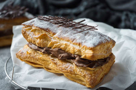 Puff pastry with confectioner's sugar and chocolate filling 写真素材