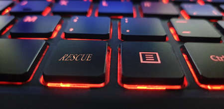 Black keyboard with red light and rescue text