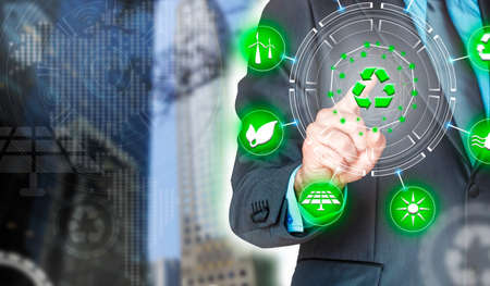 Businessman by pressing the recycling symbol. Environmental biodiversity in ecosystem concept. Backdrop as a concept of energy efficiency. The power of green energy. Concept of renewable energies
