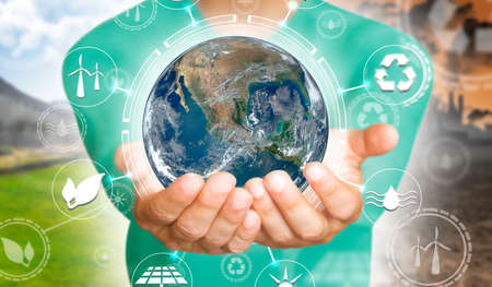 A man's hands holding a miniature Earth. Environmental biodiversity in ecosystem concept. Backdrop as a concept of energy efficiency. The power of green energy. Concept of renewable energies