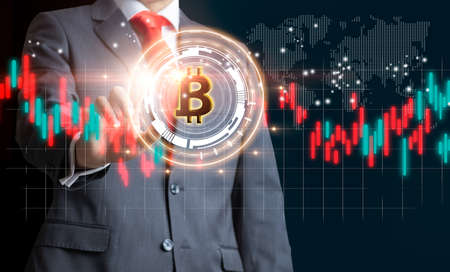 Businessman with Bitcoin currency and market exchange graphs. Stock market concept