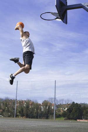 Basketball Player Slam Dunk photo