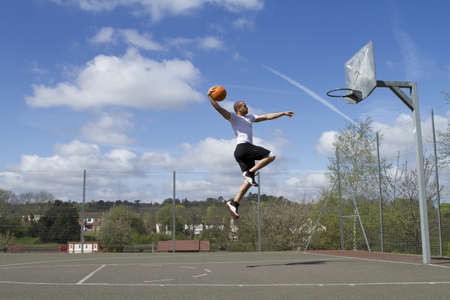 basketball hoop: Basketball Player Slam Dunk