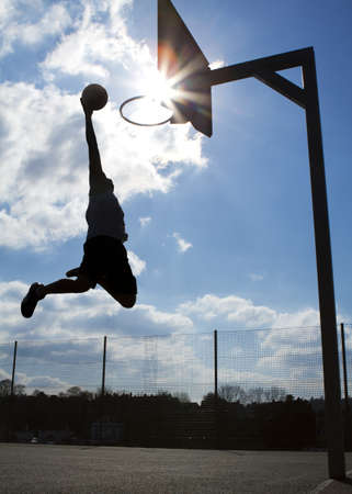 outdoor basketball court: Basketball Slam Dunk Silhouette