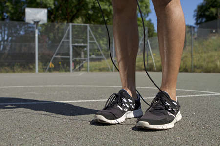 Male standing with a jump skipping rope photo