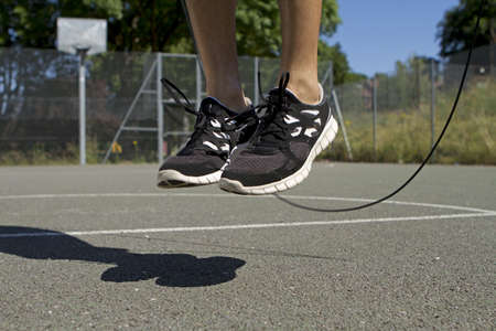 skipping rope: Male using a jump skipping rope Stock Photo