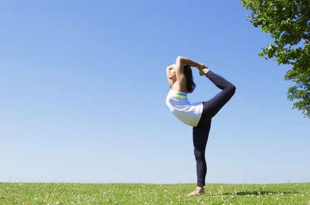 Pretty Woman in Yoga Pose Stock Photo - 21511675