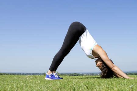 Pretty Woman in Yoga Pose photo