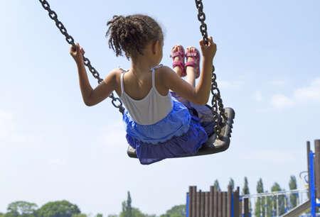 sandal tree: Little Girl on Swing Stock Photo