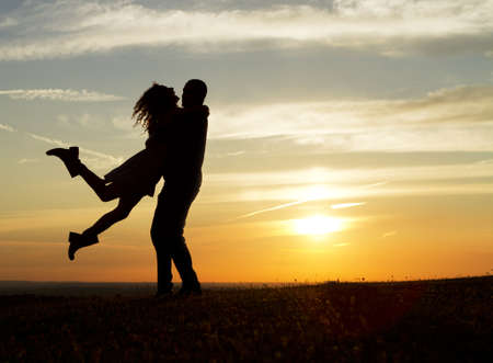 couple lit: Happy Couple at Sunset