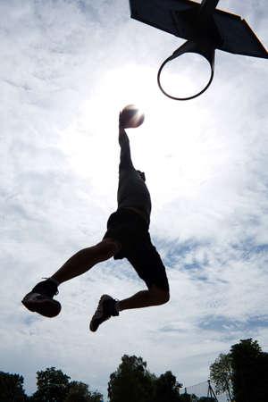 dunk: Basketball Player Slam Dunk Silhouette