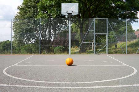 playground basketball: Basketball on a basketball court Stock Photo