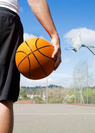 playground basketball: Basketball Player holding a basketball