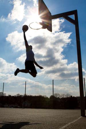 basketball hoop: Basketball Player Slam Dunk Silhouette
