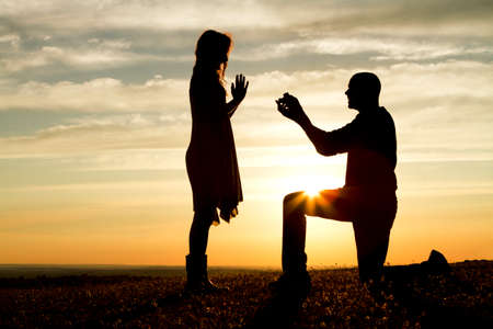 marriage proposal: Sunset Marriage Proposal Stock Photo