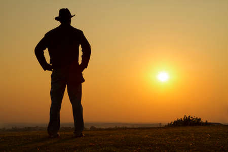 cowboy man: Cowboy gazing into the sunset