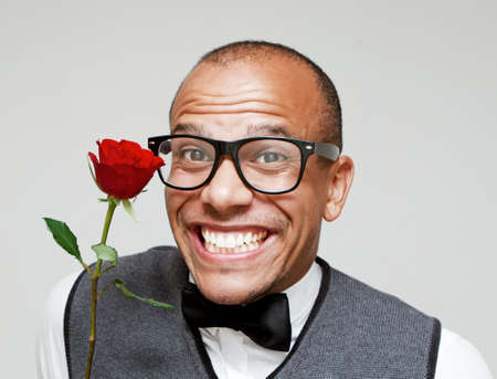 Male Geek holding a rose excitedly photo
