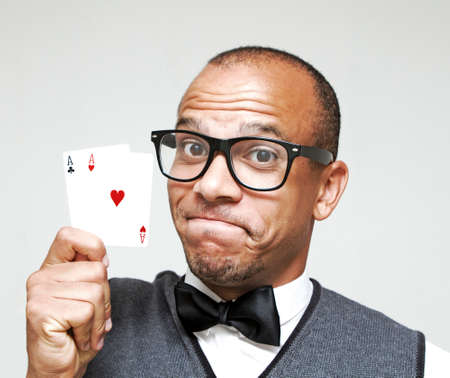 Male Geek holding a strong Poker Hand photo