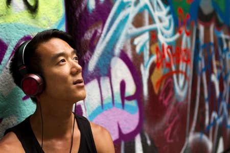 Portrait of man listening to music on his headphones photo