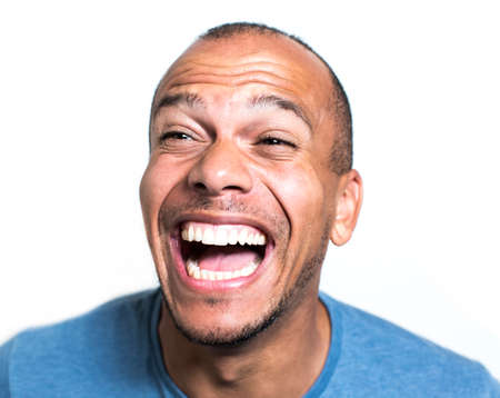 chuckling: Mixed race man laughing hysterically