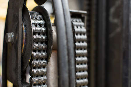 Close up of oiled chains on a forklift truck