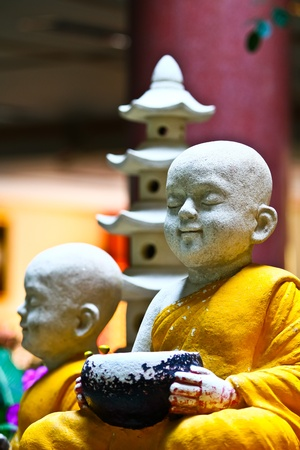 A small statue of the buddhist novice in Wat Leng Nui Yee 2, Thailand. photo