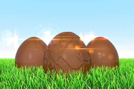 easteregg: 3 Easter eggs made of chocolate on the meadow