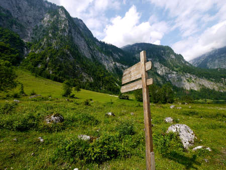 Wooden direction sign at Berchtesgaden national park, Germany photo