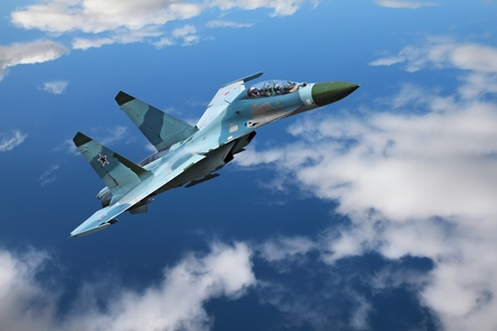 A modern fighter flies on the background of blue sky and clouds