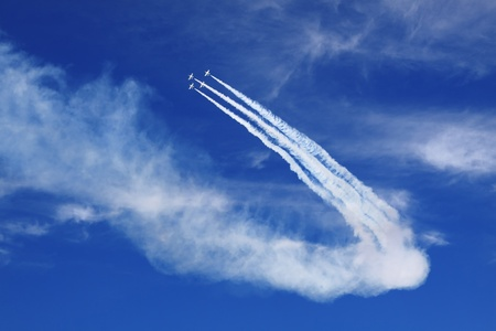 Four of the plane in the blue sky show figures of aerobatics Stock Photo - 11729907