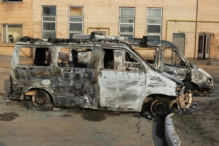 militarily: Two burnt down motor vehicles Stock Photo