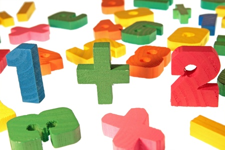 Wooden multi-coloured figures for training of children to the mathematician photo