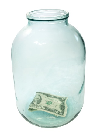 Two dollars at the bottom of the big glass jar, isolated on a white background photo