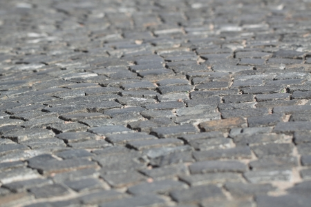 The roadway paved by a grey granite, background, small depth of sharpness 写真素材